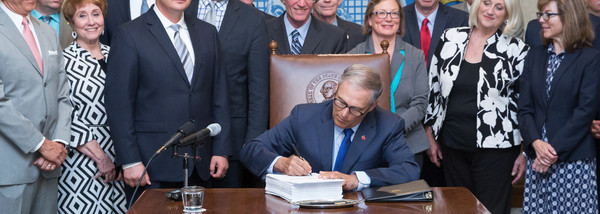 Gov. Inslee signs Substitute Senate Bill 5883 -  the 2017-2019 Washington State operating budget, June 30, 2017 in Olympia.